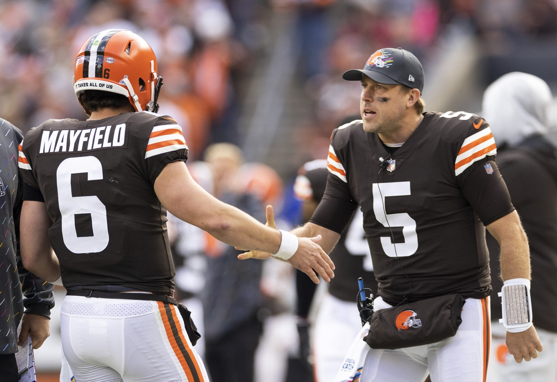 Oct 17, 2021; Cleveland, Ohio, USA; Cleveland Browns quarterback Case Keenum (5) congratulates quarterback Baker Mayfield (6) on the touchdown against the Arizona Cardinals during the second quarter at FirstEnergy Stadium. Mandatory Credit: Scott Galvin-USA TODAY Sports