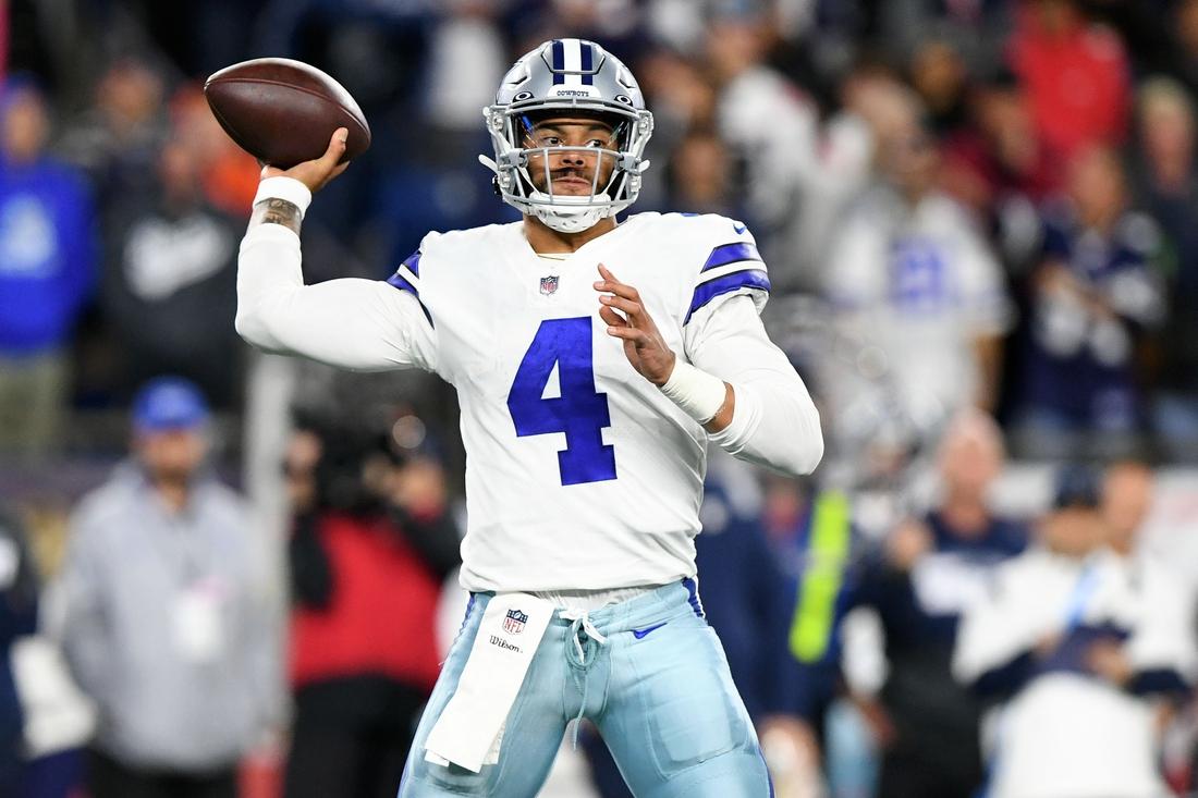 Oct 17, 2021; Foxborough, Massachusetts, USA; Dallas Cowboys quarterback Dak Prescott (4) passes the ball against the New England Patriots during the second half at Gillette Stadium. Mandatory Credit: Brian Fluharty-USA TODAY Sports