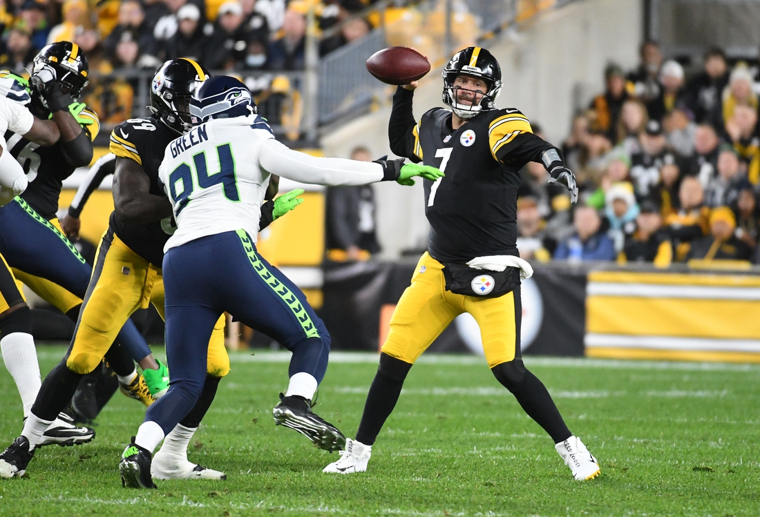 Oct 17, 2021; Pittsburgh, Pennsylvania, USA;  Pittsburgh Steelers quarterback Ben Roethlisberger (7) is pressured by Seattle Seahawks defensive end Rasheem Green (94) during the first quarter at Heinz Field. Mandatory Credit: Philip G. Pavely-USA TODAY Sports