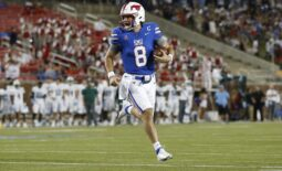 Oct 21, 2021; Dallas, Texas, USA; Southern Methodist Mustangs quarterback Tanner Mordecai (8) runs for a touchdown in the first quarter against the Tulane Green Wave at Gerald J. Ford Stadium. Mandatory Credit: Tim Heitman-USA TODAY Sports