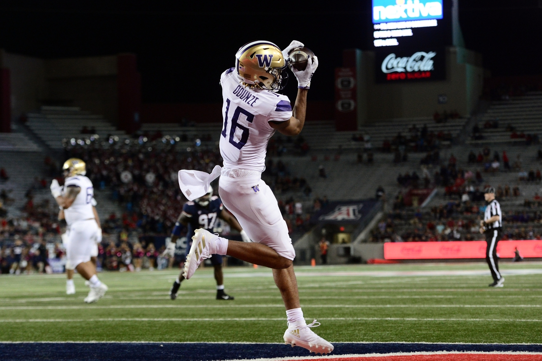 Oct 22, 2021; Tucson, Arizona, USA; Washington Huskies wide receiver Rome Odunze (16) catches a touchdown pass against the Arizona Wildcats during the second half at Arizona Stadium. Mandatory Credit: Joe Camporeale-USA TODAY Sports