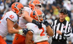Oct 23, 2021; University Park, Pennsylvania, USA; Illinois Fighting Illini running back Chase Brown (2) celebrates his touchdown run with teammates against the Penn State Nittany Lions during the first half at Beaver Stadium. Mandatory Credit: Rich Barnes-USA TODAY Sports