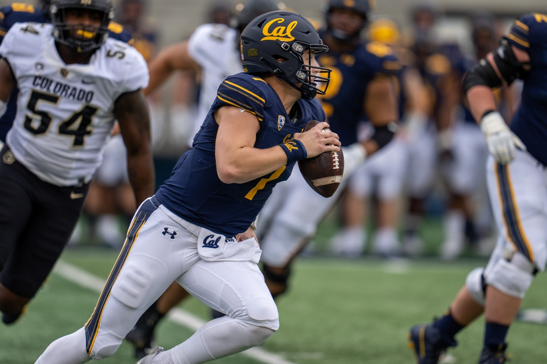 Oct 23, 2021; Berkeley, California, USA; California Golden Bears quarterback Chase Garbers (7) scrambles for the first down and passes the school record held by Joe Kapp for the most rushing yards by a quarterback for the last 60 years against the Colorado Buffaloes during the first quarter at FTX Field at California Memorial Stadium. Mandatory Credit: Neville E. Guard-USA TODAY Sports