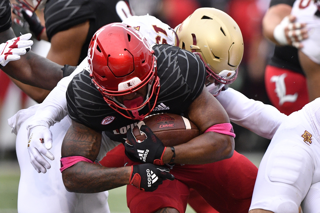 Oct 23, 2021; Louisville, Kentucky, USA;  Louisville Cardinals running back Jalen Mitchell (15) pushes past Boston College Eagles linebacker Isaiah Graham-Mobley (19) to score a touchdown during the second quarter of play at Cardinal Stadium. Mandatory Credit: Jamie Rhodes-USA TODAY Sports
