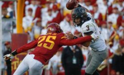 Iowa State sophomore defensive back T.J. Tampa Jr., hits Oklahoma State quarterback Spencer Sanders in the third quarter on Saturday, Oct. 23, 2021, at Jack Trice Stadium in Ames.  20211023 Iowastatevsokst