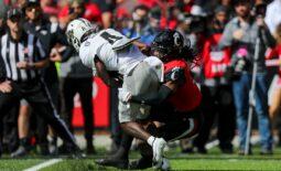 Oct 16, 2021; Cincinnati, Ohio, USA; Cincinnati Bearcats cornerback Arquon Bush (9) brings down UCF Knights wide receiver Ryan O'Keefe (4) in the first half at Nippert Stadium. Mandatory Credit: Katie Stratman-USA TODAY Sports