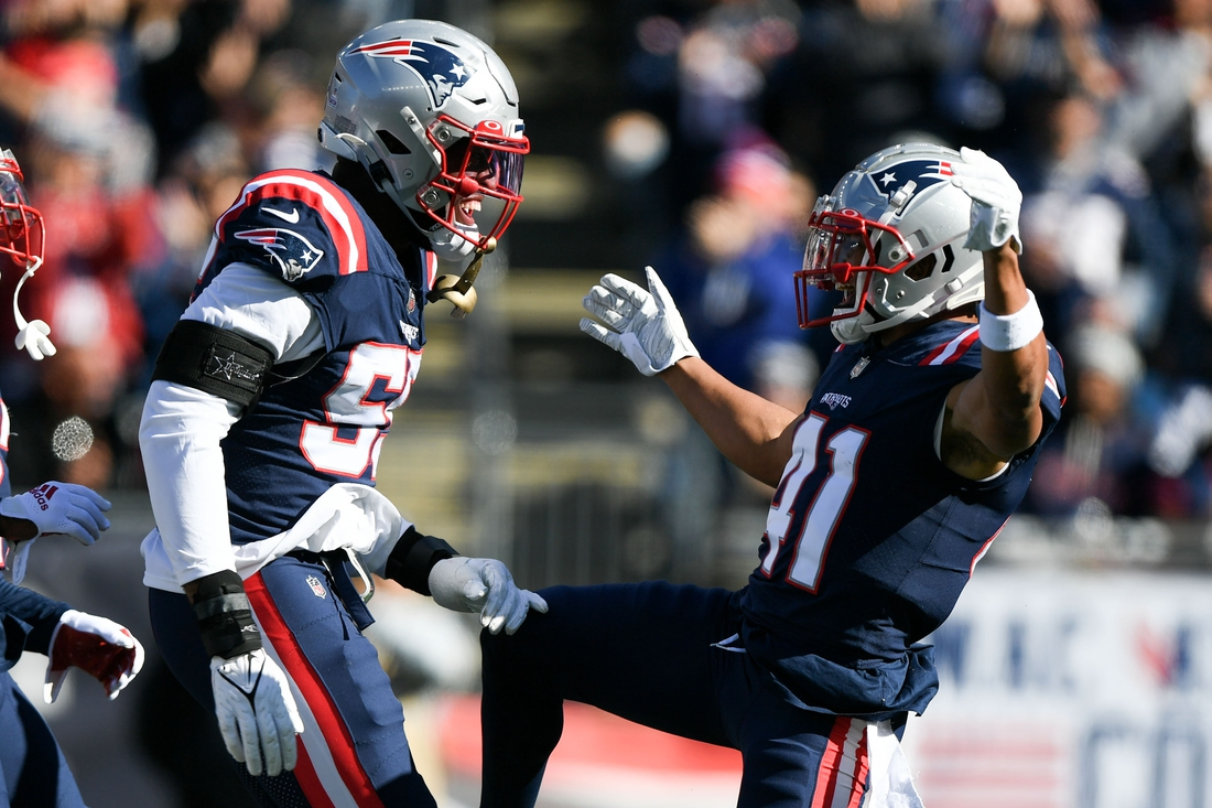 Oct 24, 2021; Foxborough, Massachusetts, USA;  New England Patriots cornerback Myles Bryant (41) reacts with linebacker Josh Uche (55) after sacking New York Jets quarterback Zach Wilson (not seen) during the first half at Gillette Stadium. Mandatory Credit: Brian Fluharty-USA TODAY Sports