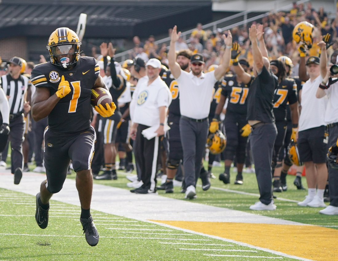 Oct 9, 2021; Columbia, Missouri, USA; Missouri Tigers running back Tyler Badie (1) scores a touchdown against the North Texas Mean Green during the game at Faurot Field at Memorial Stadium. Mandatory Credit: Denny Medley-USA TODAY Sports