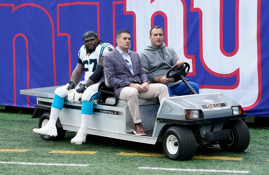 Oct 24, 2021; East Rutherford, NJ, USA; Carolina Panthers guard John Miller (67) is carted off the field after being injured at MetLife Stadium. Mandatory Credit: Robert Deutsch-USA TODAY Sports